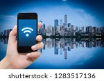 smart phone in hand and using... | Shutterstock . vector #1283517136