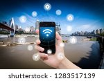 smart phone in hand and using... | Shutterstock . vector #1283517139