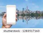 business man hand holding white ... | Shutterstock . vector #1283517163