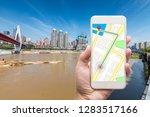 mobile gps navigation on mobile ... | Shutterstock . vector #1283517166