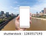 business man hand holding white ... | Shutterstock . vector #1283517193