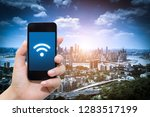 smart phone in hand and using... | Shutterstock . vector #1283517199
