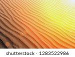 sunset desert sahara dune sand... | Shutterstock . vector #1283522986