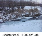 frozen river at sunset in a... | Shutterstock . vector #1283524336