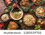 assortment of chinese food on... | Shutterstock . vector #1283529703