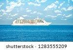 cruise ship sailing in open sea | Shutterstock . vector #1283555209