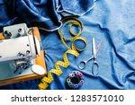 sewing indigo denim jeans with... | Shutterstock . vector #1283571010