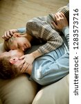 top view at loving couple lying ... | Shutterstock . vector #1283573716