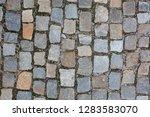 wet cobbled stone sidewalk...   Shutterstock . vector #1283583070