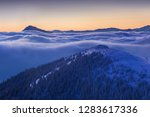 foggy morning panorama of... | Shutterstock . vector #1283617336