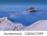 foggy morning panorama of... | Shutterstock . vector #1283617399