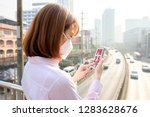 woman wearing the n95... | Shutterstock . vector #1283628676