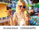 happy caucasian woman drinks... | Shutterstock . vector #1283666890
