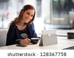 happy young woman using tablet... | Shutterstock . vector #128367758