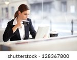 businesswoman having a cup of... | Shutterstock . vector #128367800