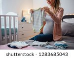 pregnant young woman holding... | Shutterstock . vector #1283685043