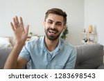friendly happy young man waving ... | Shutterstock . vector #1283698543