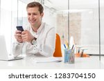 businessman smiling while using ...   Shutterstock . vector #1283704150
