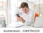 mid adult businessman grooming...   Shutterstock . vector #1283704153