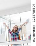 excited businesswoman with...   Shutterstock . vector #1283705509