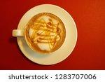 top view of hot caramel...   Shutterstock . vector #1283707006