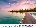 panorama of wide sandy beach on ... | Shutterstock . vector #1283710900