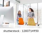 businesswomen pushing chairs in ...   Shutterstock . vector #1283714950