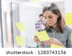 young businesswoman reading...   Shutterstock . vector #1283743156