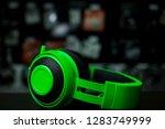 big green headphones on a dark... | Shutterstock . vector #1283749999