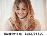 cute blonde sweater portrait  ...   Shutterstock . vector #1283796520
