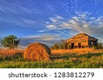 A Hay Bale In Front Of An...