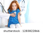 doctor examining a little girl... | Shutterstock . vector #1283822866