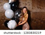 attractive happy woman with... | Shutterstock . vector #1283830219