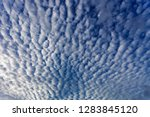 blue sky with white clouds in... | Shutterstock . vector #1283845120