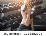 fitness woman lifting weights... | Shutterstock . vector #1283882326
