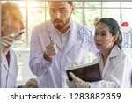 asian scientist writes a... | Shutterstock . vector #1283882359