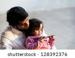 father and daughter using pc... | Shutterstock . vector #128392376
