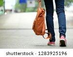 back of student girl holding... | Shutterstock . vector #1283925196