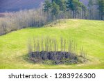 stone cairn on a field in the... | Shutterstock . vector #1283926300