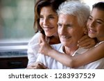 happy family hugging in a cafe. | Shutterstock . vector #1283937529