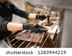 production  cooking and people... | Shutterstock . vector #1283944219