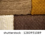 stack of warm knitwear close up....   Shutterstock . vector #1283951089