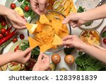people eating tasty corn chips...   Shutterstock . vector #1283981839