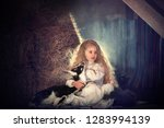 beautiful little girl with long ... | Shutterstock . vector #1283994139