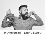 winegrower with hungry face... | Shutterstock . vector #1284011050
