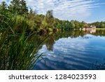 wooden house near the lake with ... | Shutterstock . vector #1284023593