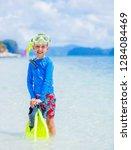 cute happy little boy carrying...   Shutterstock . vector #1284084469