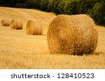 Four Straw Bale In A Field