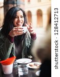 young woman drinking coffee in... | Shutterstock . vector #128412713