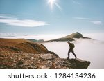 man hiking alone in mountains... | Shutterstock . vector #1284134236